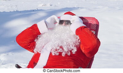 Santa Claus enjoying frosty day at winter ski resort