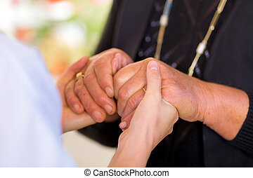 Helping hands - Close up photo of elderly woman hands hold...