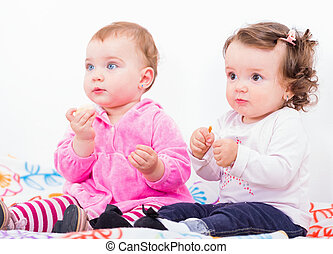 Adorable babies - Photo of two adorable baby sitting on the...