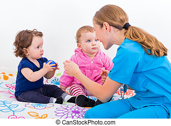 Two adorable baby at the doctor - Photo of two adorable baby...