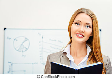 office manager - Business woman standing at the office with...