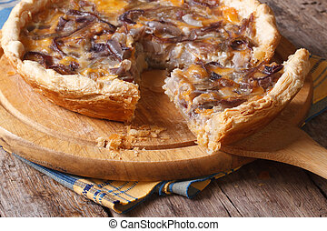 slice of onion pie with cheese horizontal close-up - slice...