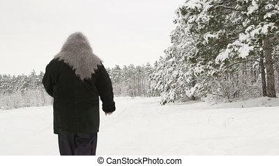 woman walking on snowy road