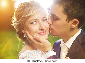 Young wedding couple on summer meadow - Young wedding couple...