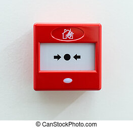 Fire alarm button on the wall.
