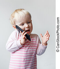 Baby talking over phone - Cute adorable white Caucasian...