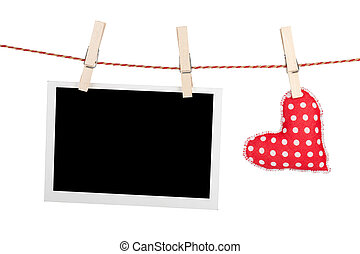 Blank instant photo and red heart hanging Isolated on white...