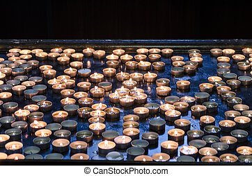 Candles in a church - Candles donation in a church in memory...