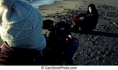 Female director shooting with model - Woman with camera...