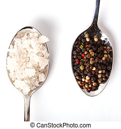 Heap of sea salt and peppercorn on a white background