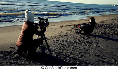 Woman shooting with camera model wa - Female director...