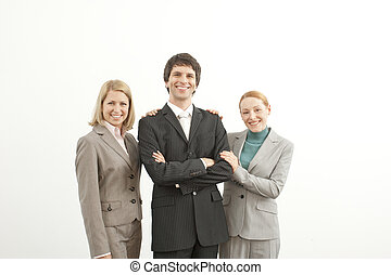 Three people - Three confident businesspeople standing and...