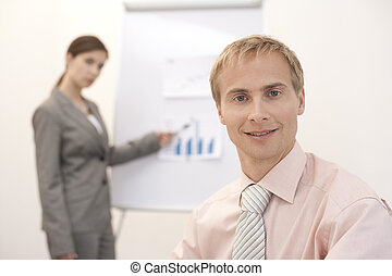 Young Businessman - Young Ceo, looking into camera, sitting...