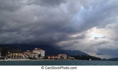 Montenegro time lapse the mountain over sea clouds dark blue