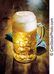 Glass tankard of cold golden ale or beer with a good frothy...