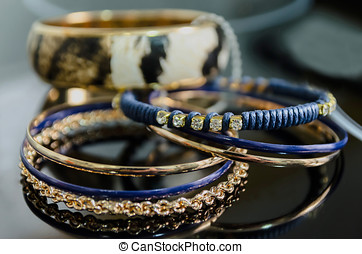 Imitation jewelry - Some shiny bracelets made in golden and...