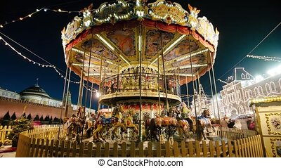 Christmas carousel. Time-Laps - Carousel on Red Square on...
