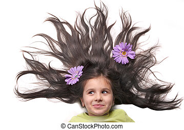 Little girl with fanned hair and flowers - Little girl...