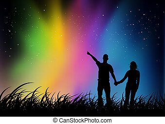 Couple watching Northern Lights - A youth couple watching an...