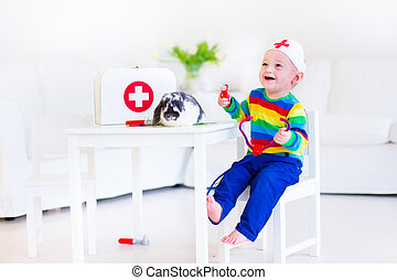 Little boy playing doctor - Cute laughing baby boy playing...