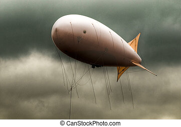 dirigible in the sky - big dirigible flying in the dramatic...