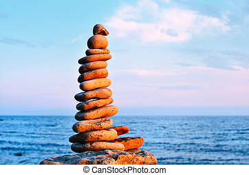 Harmonious - Balancing of stones each other on the seashore