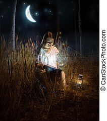 beautiful woman sitting at night forest and reading fairy...