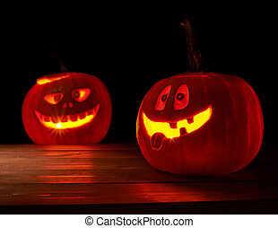 Two glowing jack o lantern pumpkins - Composition of two...