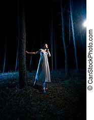 woman in white nightgown looking at beam of light at night...