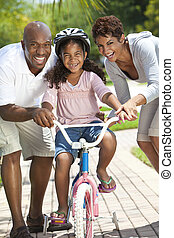 African American Family WIth Girl Riding Bike & Happy...