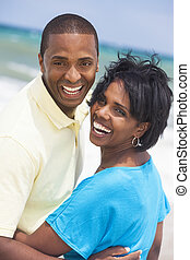 African American Man & Woman Couple Laughing on Beach