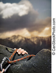 Rockclimber - A rockclimber\'s hand on the final ledge.