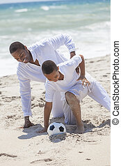 African American Father Son Playing Soccer Beach - A happy...