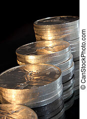 growth pile of pure silver coins from mexico named onza...