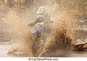 Motocross Driver - Motocross racer in a wet and muddy...