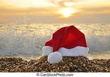 Tropical christmas - Santa Claus hat on the beach