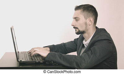 Business man computer programmer typing at his desk and...