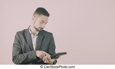Businessman with tablet computer pc - Young businessman with...
