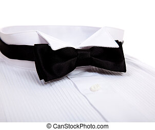 A bow tie and Tuxedo shirt - A black bow tie and a tuxedo...