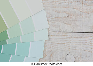 Paint Chips Fanned Out on Table - High angle closeup of...