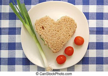 Nutrition - Heart shaped sandwich on a checkered tablecloth