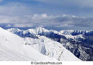 Off-piste slope and snowy mountains. Caucasus Mountains,...