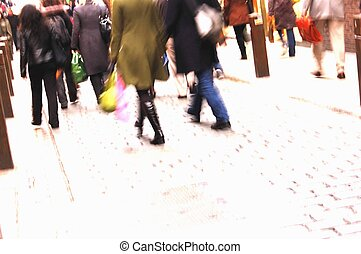 Shoppers walking down a busy high street