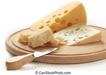 Cheeses on a cheese board - Three varieties of cheeses on a...