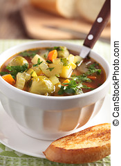 Minestrone in a white bowl closeup