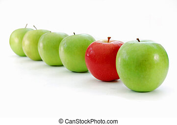One of a kind - Red apple stands out in a line of green...