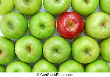 Stand out from the crowd - Red apple amongst many green ones