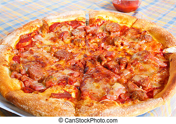 Meat deluxe pizza. - delicious pizza with meat deluxe.