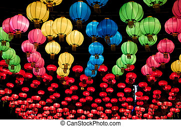 Chinese lanterns hanging in street at night during the...