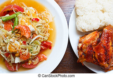 Papaya salad with grilled chicken and sticky rice ,...